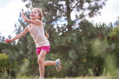 Happy girl playing frisbee Royalty Free Stock Images