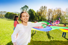 Happy girl playing funny game outdoor with friends Royalty Free Stock Photography