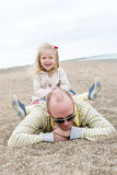 Happy girl playing with her father Stock Photos