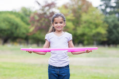 happy girl playing with hula hoops Stock Image