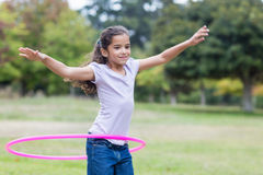 happy girl playing with hula hoops Stock Photos