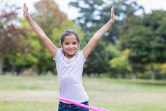 Happy girl playing with hula hoops Royalty Free Stock Photos