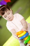 Happy girl playing. Happy little girl playing outdoors Royalty Free Stock Photos