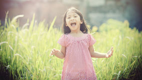 Happy Girl Playing Outdoor Stock Photography