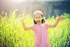 Happy Girl Playing Outdoor Stock Photo