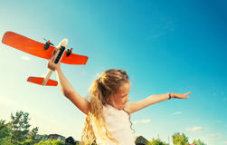 Happy girl playing with plane. Child playing with plane. Happy girl play outdoors Royalty Free Stock Photos