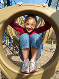 Happy girl playing at playground. Stock Image