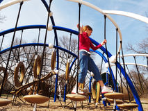 Happy girl playing at playground. Royalty Free Stock Photography