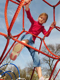 Happy girl playing at playground. Stock Photography