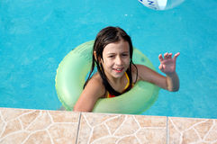 Happy girl playing in pool Royalty Free Stock Photography