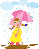 Happy girl playing in the rain Stock Images