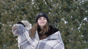 Happy girl playing with snowballs in the park. Slow motion.  stock video footage