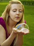 Happy girl playing with soap bubbles Stock Image