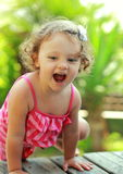 Happy girl playing on summer green Royalty Free Stock Photo