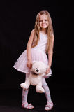 Happy girl playing with teddy bear Royalty Free Stock Images