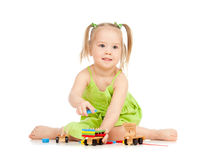 Happy girl playing toy train on floor Stock Image