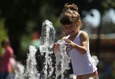 Happy girl playing with water Royalty Free Stock Images