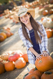 Happy Girl Playing with a Wheelbarrow at the Pumpkin Patch Stock Photography