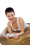 The happy girl plays video game. By joystick Stock Photos