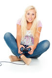 Happy Girl Plays Video Games Stock Photography