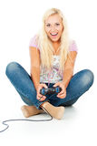 Beautiful girl plays video games Stock Photo