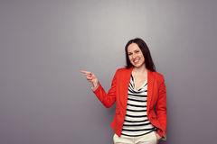 Happy girl pointing at empty copyspace Royalty Free Stock Images