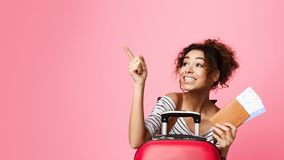 Happy Girl Pointing Finger Away, Pink Background royalty free stock photo
