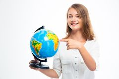 Happy girl pointing finger on globe Stock Image
