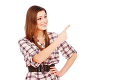 Happy girl pointing at something stock photo