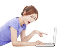 Happy girl pointing to the laptop Royalty Free Stock Photo