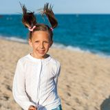 Happy girl with ponytails. Stock Photos