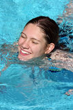 Happy girl in a pool royalty free stock photos