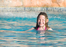 Happy girl in pool Stock Images