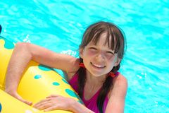 Happy girl in pool Royalty Free Stock Images
