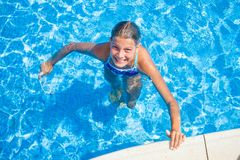 Happy girl in the pool Royalty Free Stock Images