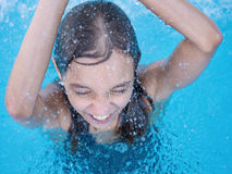 Happy girl in pool Royalty Free Stock Image