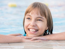 Happy girl in pool Royalty Free Stock Photography