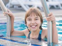 Happy girl in pool Stock Image