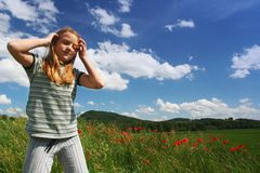 Happy girl on poppies field royalty free stock photo