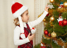 Happy girl portrait in christmas decoration, winter holiday concept, decorated fir tree and gifts Royalty Free Stock Images
