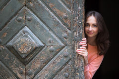 A happy girl poses for the photographer in the old Krakow. Stock Photos