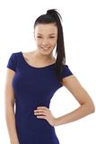 Happy girl posing in blue top Royalty Free Stock Image