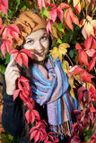 Happy girl posing with colorful autumn foliage Stock Images