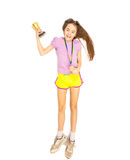 Happy girl posing with cup and gold medal. Isolated shot on floo Royalty Free Stock Photo