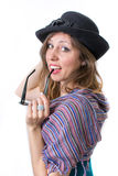 Happy girl posing with a hat and sunglasses Stock Photo