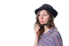 Happy girl posing with a hat and sunglasses Royalty Free Stock Image