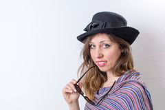 Happy girl posing with a hat and sunglasses Royalty Free Stock Images