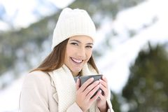 Happy girl posing holding a coffee mug in winter stock photos