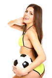 Happy girl posing with a soccer ball on a white background Royalty Free Stock Photography