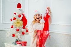 Happy girl preparing to celebrate new year and merry christmas. Red lingerie for Christmas women. Xmas fashion. Happy girl preparing to celebrate new year and royalty free stock photo